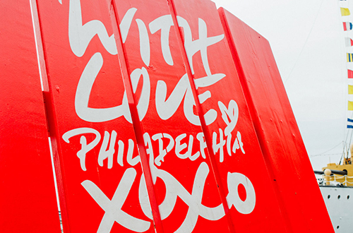 Visit Philadelphia red chair in Spruce Street Harbor Park in Philadelphia Pennsylvania