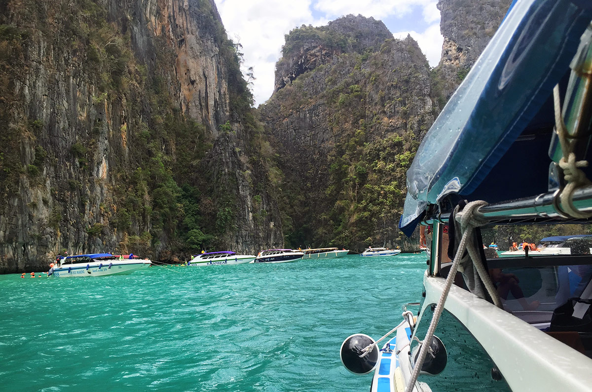Thalassa Tours speed boat in a bay of the Phi Phi Islands in Southeast Asia